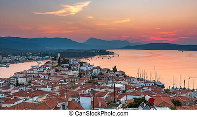 Timelapse of aerial view on Poros, Greece at sunset -...