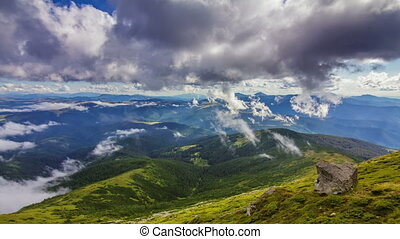 Timelapse of beautiful summer landscape in Carpathian mountains with clouds passing by against blue sky