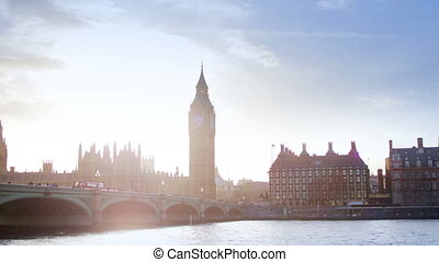 timelapse of big ben and houses of parliament, shooting into the sun for effect, london