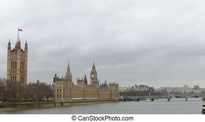 timelapse of big ben, in london with traffic on the streets