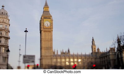 timelapse of big ben, in london, with traffic, shot with a tilt shift lens