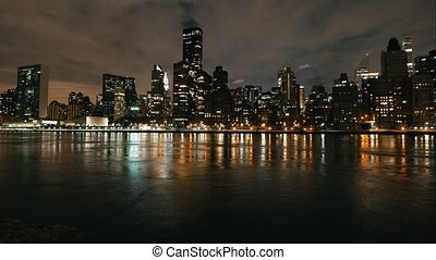 Timelapse of big city - night skyline Manhattan skyscrapers,...