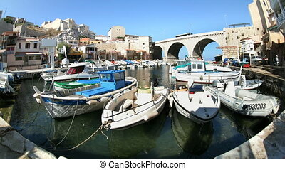 timelapse of boats and yachts moored in the picturesque Vallon des Auffes harbour, Marseille, France.