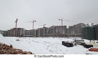 Timelapse of building residential compound in winter, Russia