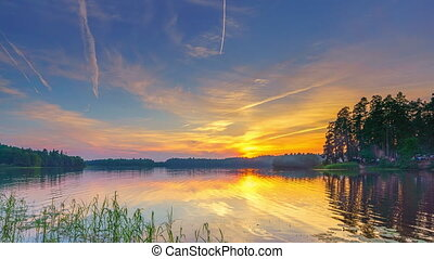 Timelapse of calm beautiful sunset over forest lake -...