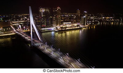 Timelapse of car traffic on Erasmus Bridge in night Rotterdam