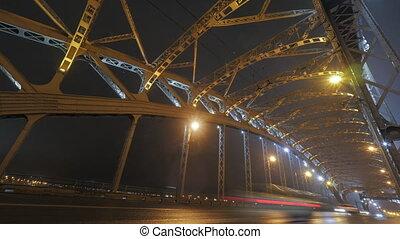 Timelapse of car traffic on the bridge at night