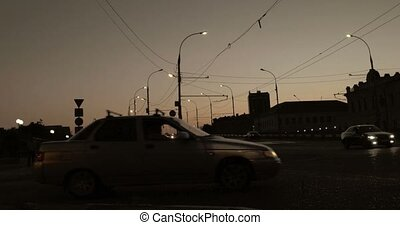 Timelapse of cars fast moving in the dark. Modern city night...
