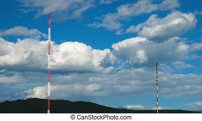 Timelapse of cityscape with television tower ans clouds