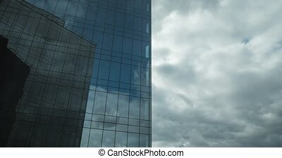 Timelapse of clouds moving and reflecting in glassy...