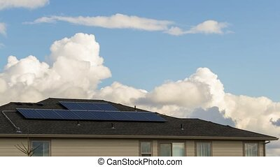 Timelapse of clouds over a home with a Solar Panel system installed on roof 4k