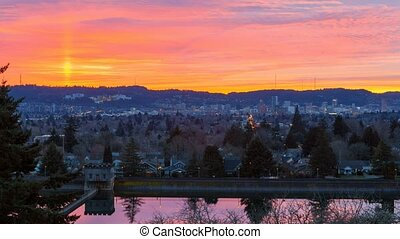 Timelapse of colorful sunset and clouds over downtown city of Portland Oregon