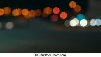 Timelapse of defocused night city traffic
