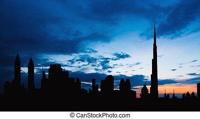 Timelapse of Dubai cityscape silhouette on sunset in UAE