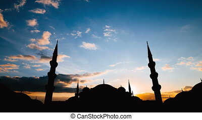 Timelapse of famous Sultanahmet or Blue Mosque in Istanbul cityscape at sunset, Turkey