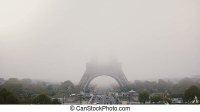 Timelapse of foggy Eiffel Tower. Paris, France. Atmospheric...