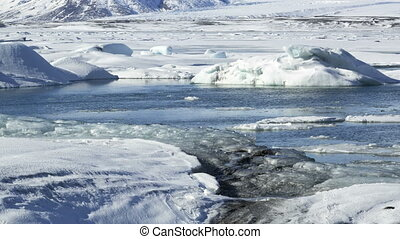 Timelapse of glacier lagoon - Timelapse of ice blocks at...
