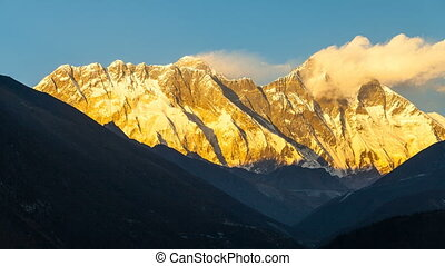 Timelapse of Golden Everest, Himalayas, landscape between way to Everest Base Camp,Nepal.Snow capped mountain top highest in the world.