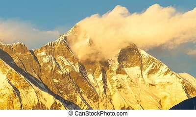 Timelapse of Golden Everest, Himalayas, landscape between...