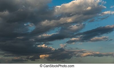 Timelapse of gray evening clouds - Gray and white clouds in...