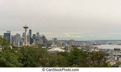 Timelapse of gray sky over Seattle WA cityscape and Mt...