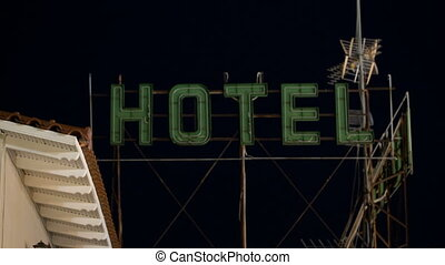 Timelapse of hotel banner blinking at night