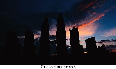 Timelapse of Kuala Lumpur cityscape silhouette on sunset in...