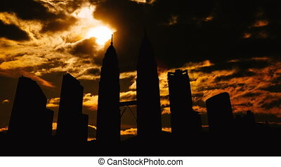 Timelapse of Kuala Lumpur cityscape silhouette on sunset in...