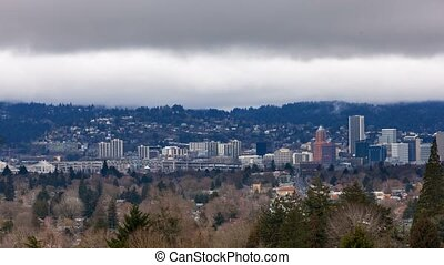 Timelapse of low clouds over city skyline and auto traffic downtown Portland Oregon one winter day 4k uhd