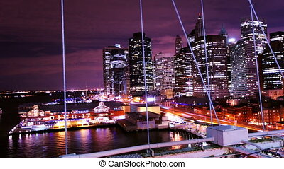 timelapse of lower manhattan shot from brooklyn bridge at night, new york