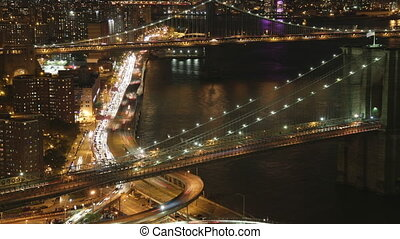 timelapse of lower manhattan skyline and brooklyn bridge from a high vantage point at night