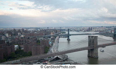 timelapse of lower manhattan skyline and brooklyn bridge from a high vantage point