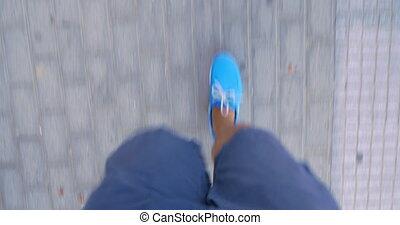 Timelapse of male feet walking on sidewalk