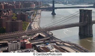 timelapse of manhattan skyline and brooklyn bridge from a high vantage point