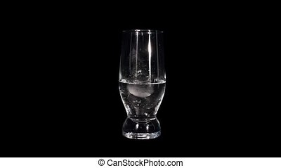 ice cubes in a glass - Timelapse of melting ice cubes in a...
