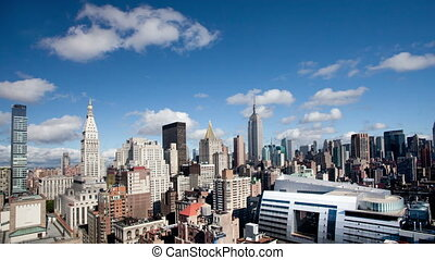 timelapse of midtown manhattan skyline with the empire state from a high vantage point on a beautiful clear day