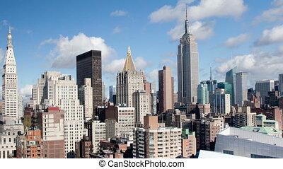 timelapse of midtown manhattan skyline from a high vantage...