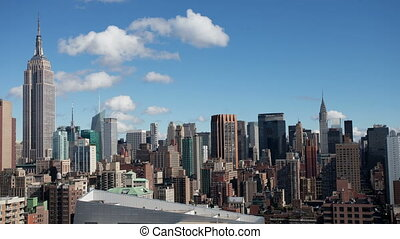 timelapse of midtown manhattan skyline with the empire state...