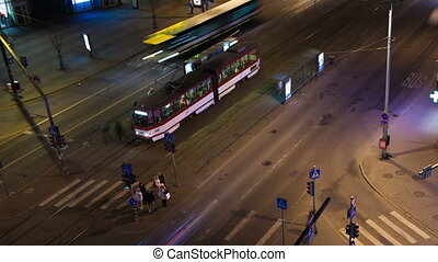 Timelapse of night city traffic in Tallin with pedestrians and public transport