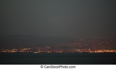 Timelapse of night getting to the coastal city