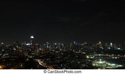Timelapse of night illuminated Bangkok city, Thailand