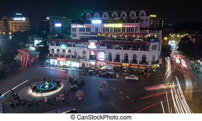 Timelapse of night traffic on the square in Hanoi, Vietnam