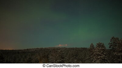 Timelapse of northern lights over the woods - Timelapse shot...