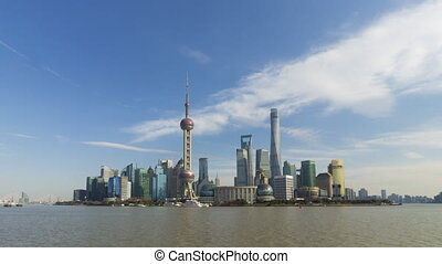 Timelapse of Panoramic Shanghai Cityscape at Sunny Day with Blue Sky. Lujiazui Financial District and Huangpu River. China.