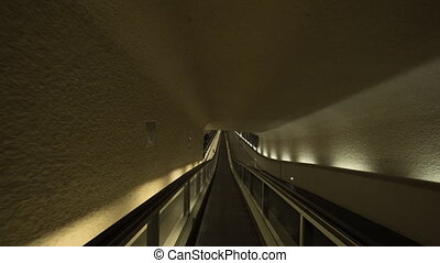 Timelapse of passing through the tunnel by travelator at the airport