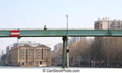 timelapse of people walking across footbridge in paris