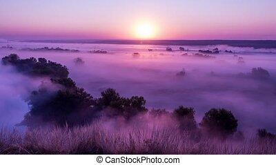 Timelapse of pink sunrise on misty valley of Siverskiy ...