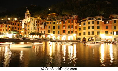 timelapse of portofino harbour at night, italy
