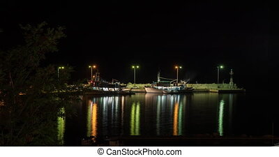 Timelapse of quay with boats at night, Greece - Timelapse...