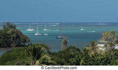 Timelapse of sailing yachts neat the coastline, Mauritius